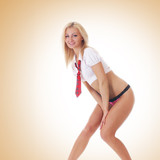 A young and sexy blond is standing in erotic pink lingerie poster