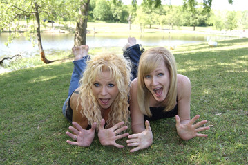 Two Sexy Blond Mature Women Playing in the Park