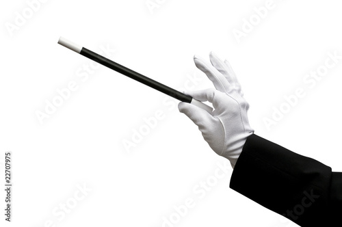 Hand holding a magic wand