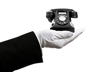 Butler holding telephone
