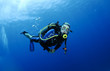 scuba diver in clear blue water