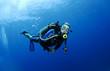scuba diver in clear blue water
