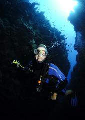 scuba diver in cave