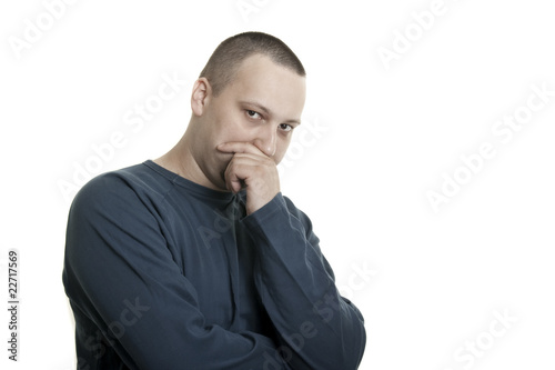 suspicious young caucasian man with short hair and beard
