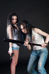 two girls with weapons