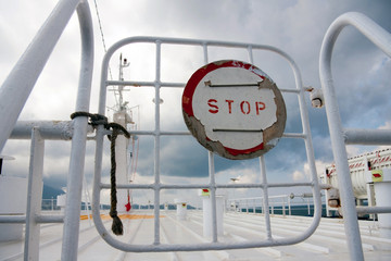 Sign Stop on a gate on boat
