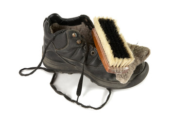 Old boot with  shoe brush
