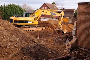 Excavator at demolition site