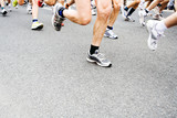 Marathon runners. Motion blur on running legs