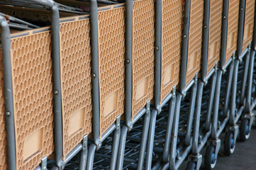 Retail image of a row of supermarket carts