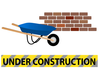Under construction site with wheelbarrow and wall