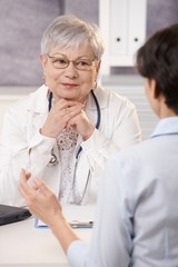 Doctor looking at patient, smiling