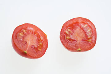 two halwed tomatoes