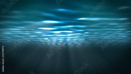 Underwater scene with sunrays shining through the water.