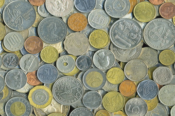 background of many coins from different countries