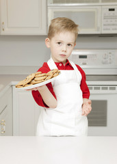 Young Baker Holding a Plate of Cookies