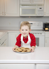 Chef offering plate of cookies to viewer