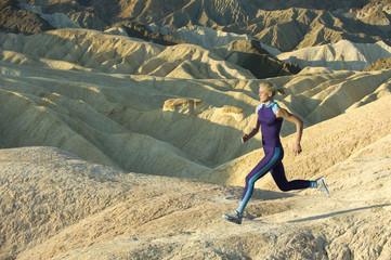 Runner in high mountains