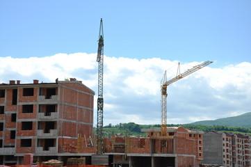 construction site where cranes are