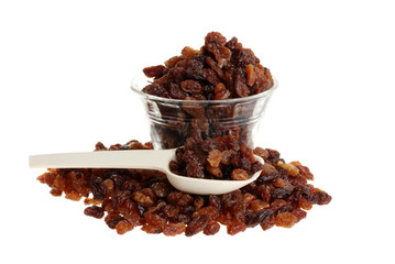 raisins with bowl and measuring spoon