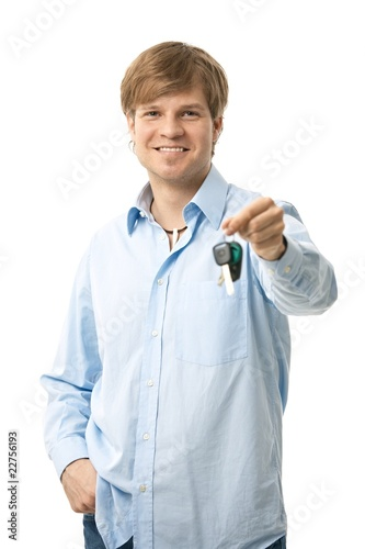 Young man holding ignition keys