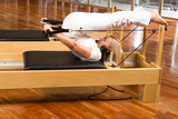 Beautiful woman on a reformer