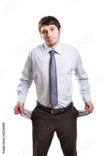 Sad and broke businessman with empty pockets