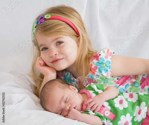 Sister Laying with New Baby Sister