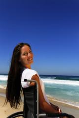 woman in wheelchair enjoying outdoors beach
