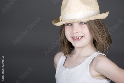 Cute Blonde Child in Straw Hat