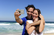 couple taking a photo with a digital compact camera