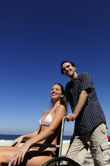 couple on vacation: woman sitting in a wheelchair