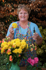 mature lady working flowers outside portrait