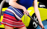 Attractive woman cleaning car saloon poster