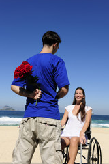 man hiding red roses, a gift for his handicapped girlfriend