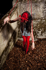 Beautiful girl posing as a marionette (puppet on a string)