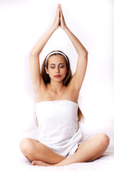 Young woman doing yoga and relaxing herself