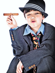 boy with a jazz costume wearing a trilby hat & holding a cigar