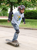 child skateboarding with helmet, knee pads & elbow protection poster