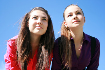 Two young women looking ahead