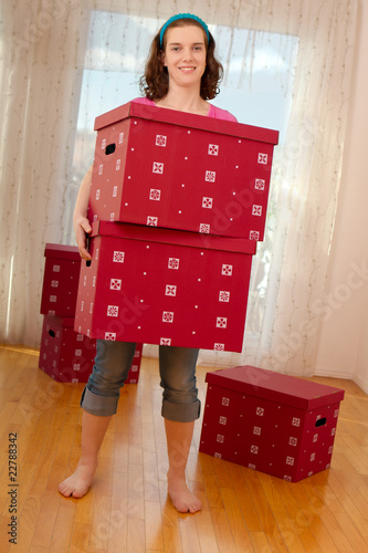 Attractive woman with big boxes in hands