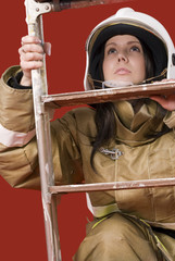Girl in fireman uniform upstairs