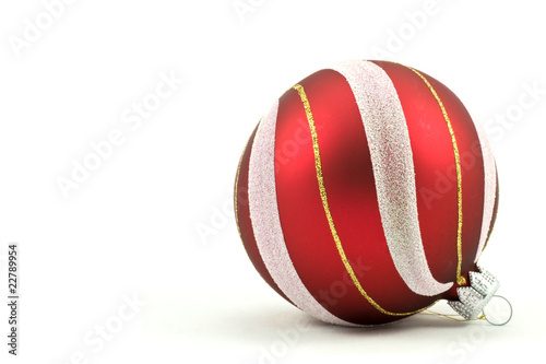 red  christmas ball with  ornament. Isolated on white