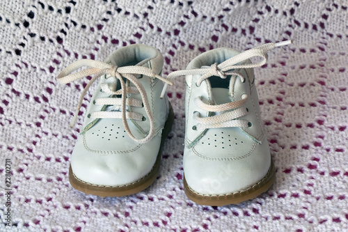 White leather baby shoes,worn