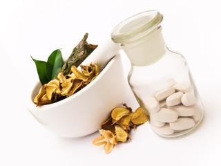 White mortar and pharmacy bottle