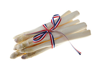bundle of fresh asparagus over white background