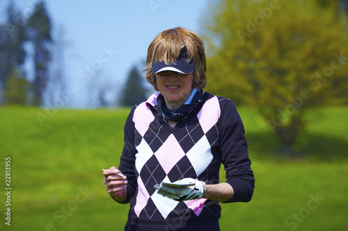 Woman at the golf  range writing down the score handicap