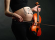 Pregnant woman with violin