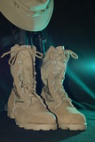 American desert army boots with hat and gun
