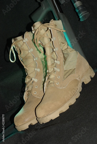Desert army boots with a rifle